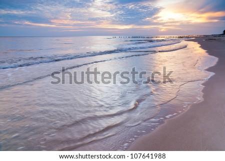 Sunrise over the Baltic sea, Poland. Landscape photograph of polish shoreline photographed at sunrise. Beautiful colorful summer scene full of warm colors.