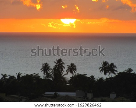 sunrise over the horizon over the ocean.