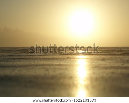 Sunrise over the iced over Ringøbingfjord in the winter in Denmark.