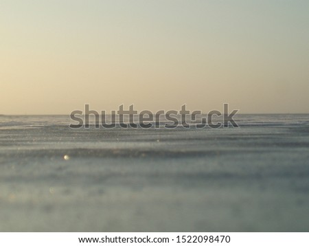 Sunrise over the iced over Ringkøbingfjord in the winter