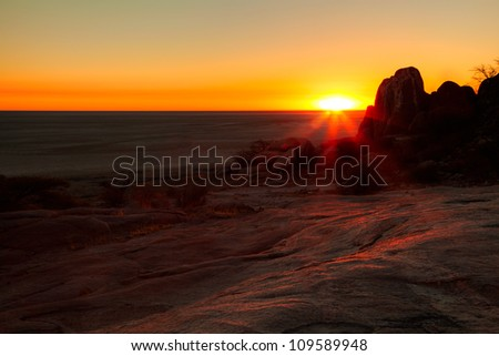Sunrise over the kgadikgadi pansin botswana, taken from kubu island