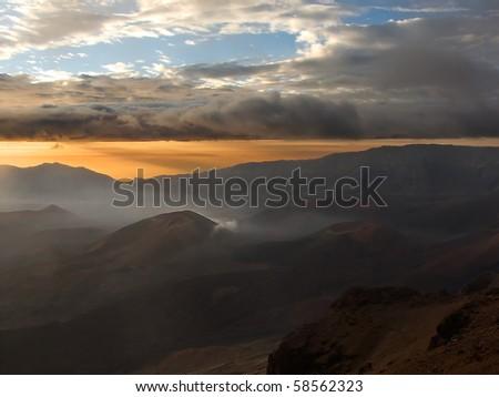 Sunrise over the lunar-like landscape of the dormant Haleakala crater, Maui, Hawaii.