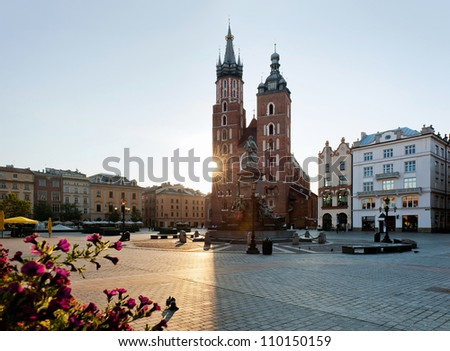 Sunrise over the market square in Krakow.Beautiful old part of Krakow city photographedi n warm  light of sunrise.