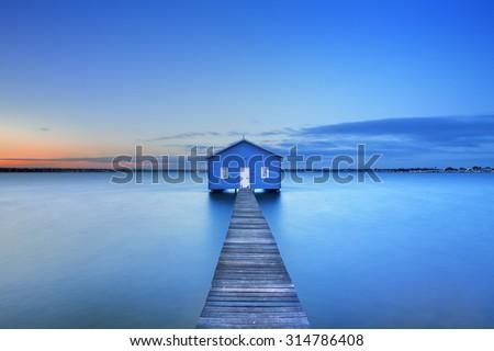 Sunrise over the Matilda Bay boathouse in the Swan River in Perth, Western Australia.