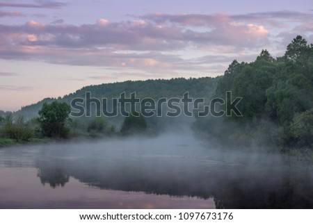 sunrise over the misty river #1097673176