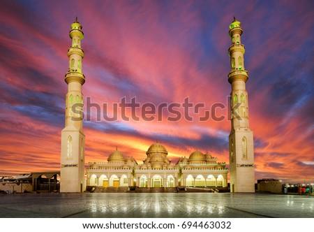 Sunrise over the mosque Hurghada, Egypt #694463032