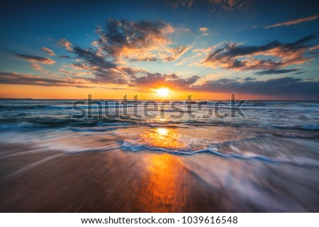 Sunrise over the sea and beautiful cloudscape. #1039616548