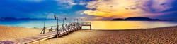 Sunrise over the sea. Pier on the foreground. Amazing landscape. Panorama