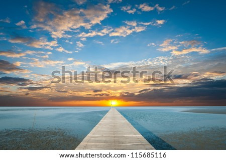 Sunrise over the sea with pier on the foreground