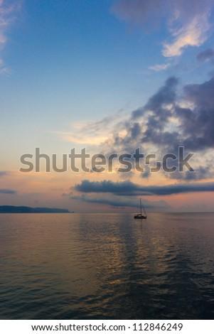 Sunrise over the sea with ship