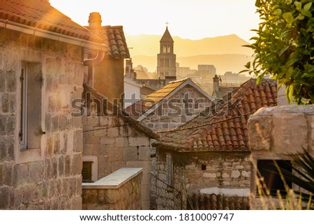 Sunrise over the Split old town. Narrow medieval paved street in old town of Split at sunrise, Croatia Photo stock ©