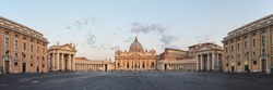 Sunrise over the St. Peters Basilica in Vatican City. Morning at the most famous landmark, empty of people street, cloudy sky. Panoramic view