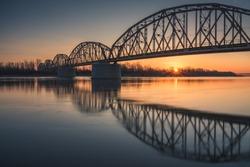 Sunrise over the trailway bridge in Gora Kalwaria, Poland