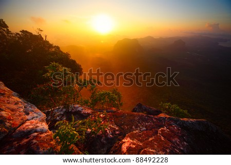 Sunrise over valley with limestone mountains