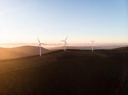 Sunrise panorama of wind turbines farm park on mountain hill top at Baloico do Trevim Lousa swing Coimbra Portugal