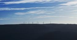 Sunrise panorama of wind turbines farm park on mountain hill top near Mondim de Basto Vila Real Norte Region Portugal Europe