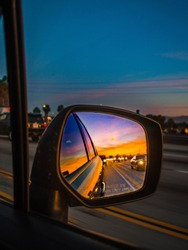 Sunrise Reflection in Side View Mirror