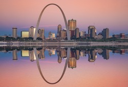Sunrise reflection of the St Louis skyline along the Mississippi River