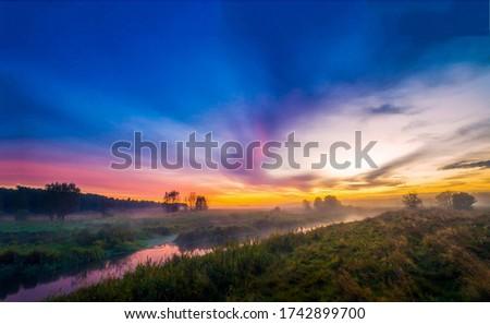 Sunrise rural nature fog landscape. Sunrise fog river view. Rural river sunrise fog landscape