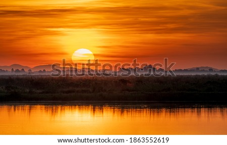 Sunrise rural river fog landscape. Mountain lake sunrise landscape. Panorama of mountains, valley on  sunrise. Sunrise fog landscape.