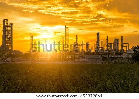 Sunrise scence of Oil Refinery factory industry with blue sky and clouds. Petrochemical plant , Petroleum , Industrial-plant. #655372861