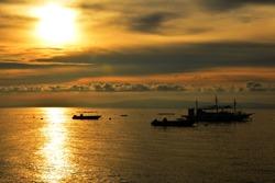 Sunrise scenery at the sea in Dauin, Negros Oriental, Philippines.