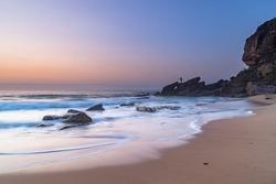 Sunrise Seascape and Fisherman from Killcare Beach on the Central Coast, NSW, Australia.