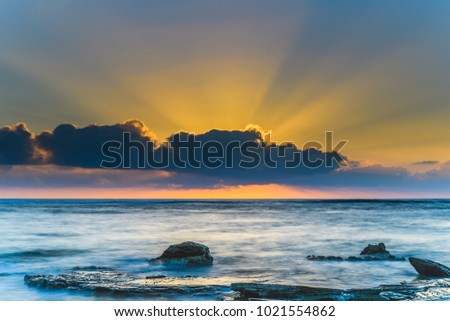 Sunrise Seascape and Sun Rays -  Capturing the sunrise from Toowoon Bay Beach on the Central Coast, NSW, Australia. #1021554862