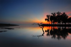 Sunrise seascape at Terengganu. Soft focus due to long exposure shot. Nature composition and vibrant colours.