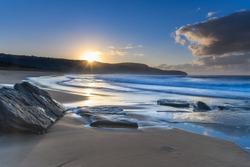Sunrise Seascape with Sunburst from Killcare Beach on the Central Coast, NSW, Australia.