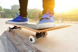 sunrise skateboarding woman legs