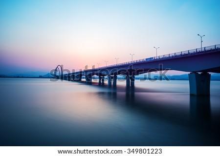sunrise skyline and landscape of bridge over river #349801223