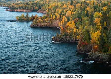Photo of  Sunrise slowly begins to light up the rocky shoreline of Tettegouche State Park along Minnesota's north shore of Lake Superior.