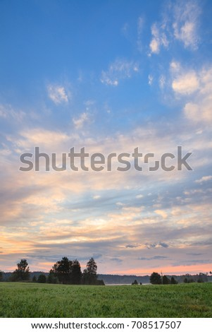 Sunrise summer morning at countryside field in Finland #708517507