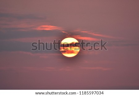sunrise sun in the clouds over the baltic sea in gdynia, poland  #1185597034