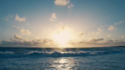 Sunrise sunny beach in Atlantic ocean big sand beach background landscape. Sun dawn or sunrise seascape place. Fantastic red sunrise over ocean on morning. Orange sun rises over ocean early in morning