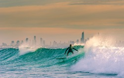 Sunrise Surf with Surfers Paradise on the Background