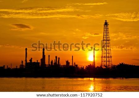 Sunrise the Oil refinery at Chao Phraya river, Bangkok Thailand
