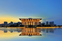 Sunrise view at Masjid Besi (Iron Mosque) or Masjid Tuanku Mizan Zainal Abidin, Putrajaya, Malaysia with reflection