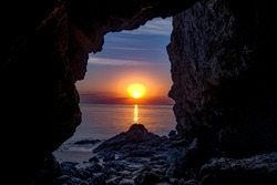 Sunrise view from Khorfakkan Heart Beach cave, Beautiful and hidden place in United Arab Emirates, Travel and tourist place in Sharjah, sunrise beach scenery