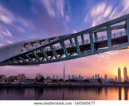 Sunrise view of Dubai Downtown from Dubai Canal  #560360677