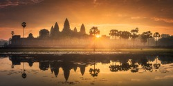 Sunrise view of popular tourist attraction ancient temple complex Angkor Wat with reflected in lake Siem Reap, Cambodia