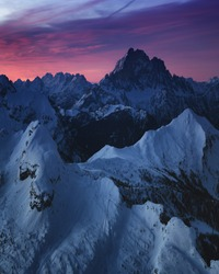 Sunrise view of the snow-capped mountains from rifugio Lagazuoi, Dolomites, Italy. Winter dawn in the mountains, the surroundings of Cortina d'Ampezzo. Morning mountain landscape, the Alps.