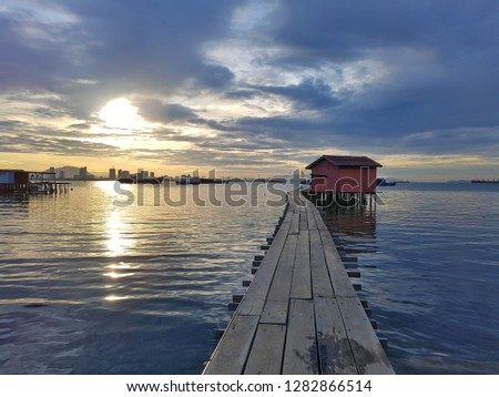 Sunrise view over Tan jetty, one of clan jetties located in UNESCO World heritage site in Georgetown city, Penang, Malaysia. #1282866514