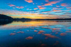 Sunrise waterscape with clouds over Brisbane Waters in Woy Woy on the Central Coast, NSW, Australia.