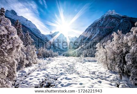 Sunrise winter snow mountains landscape. Winter mountain sunrise scene
