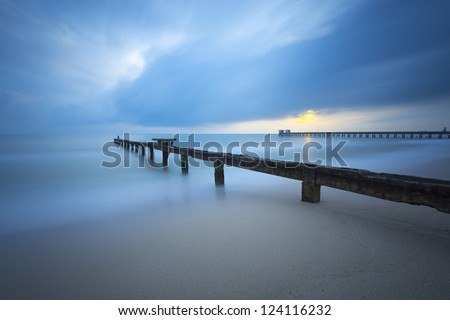 sunrise with a fishing bridge with long exposure