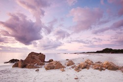 sunrise with amazing colors on the beach of Cala Ginepro, Sardinia, Italy