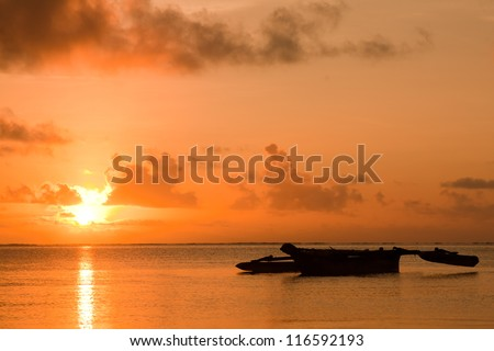 Sunrise with an African boat (dhow) in the foreground