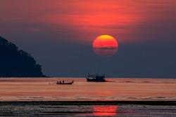 Sunrise with fishing boat